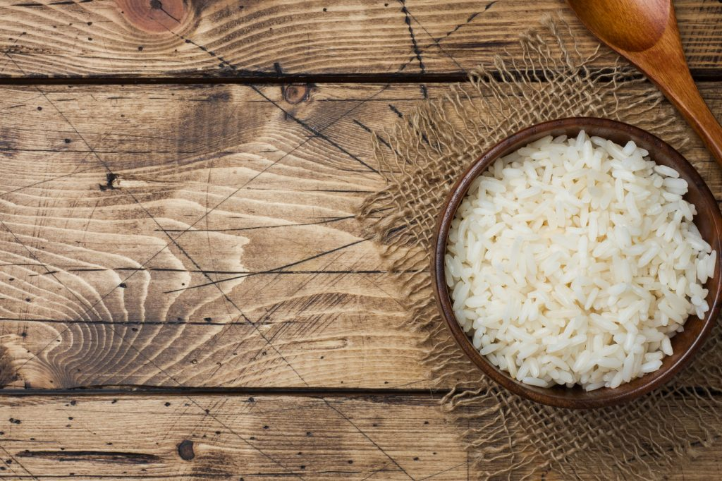 White boiled rice in a wooden bowl