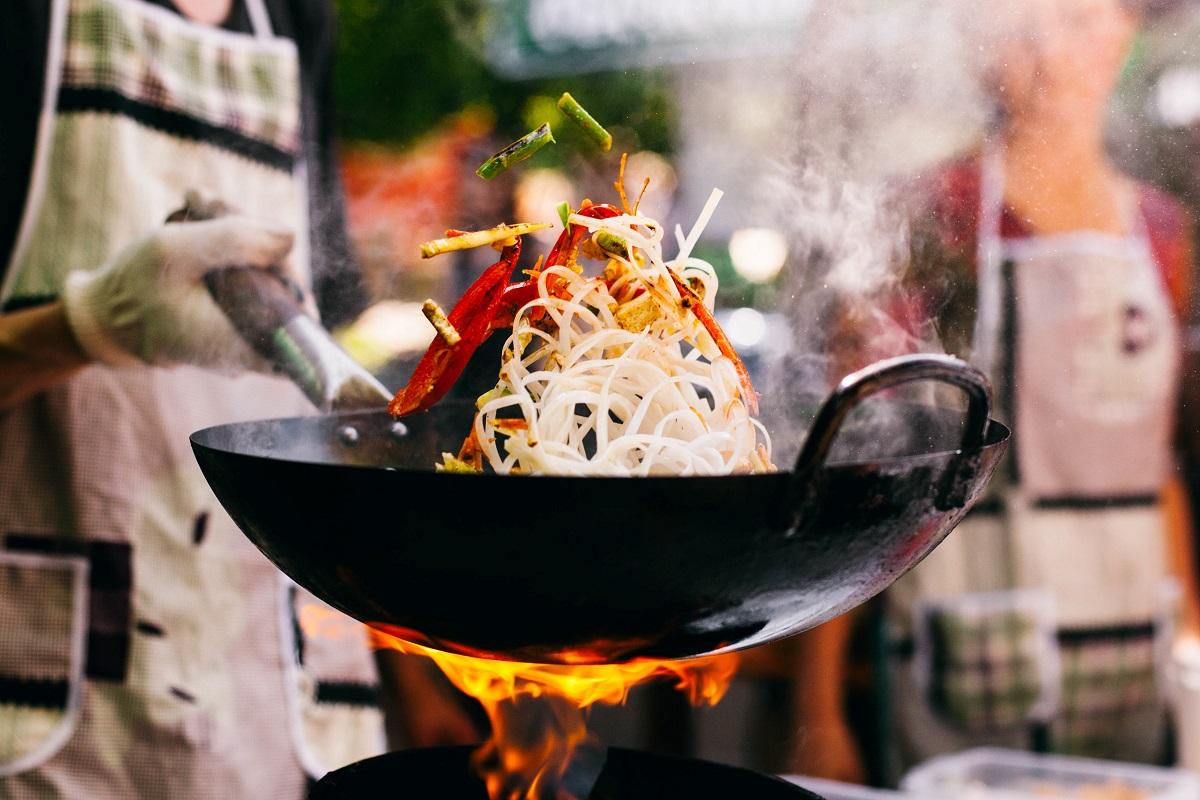 Man cooks noodles